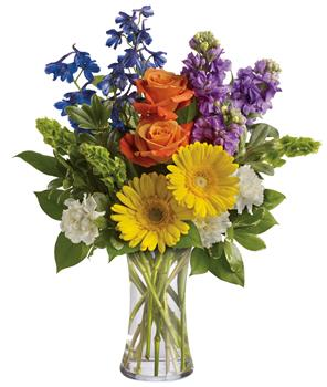 Code: A44V. Name: Beautiful Day. Description: Refresh the senses with the splendour of this colourful blend of gerberas, roses, stock, delphinium and Bells of Ireland in a vase. Price: GBP £63.75