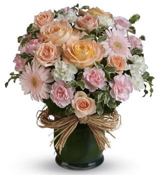 Code: A62V. Name: She is Lovely. Description: Indeed she is! Show her with this soft symphony of feminine blooms, including roses, gerberas and carnations in a raffia lined vase. Price: GBP £78.38